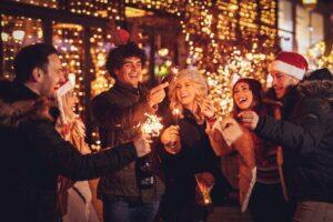 three-couple-sparklers-enjoying-christmas-outdoor